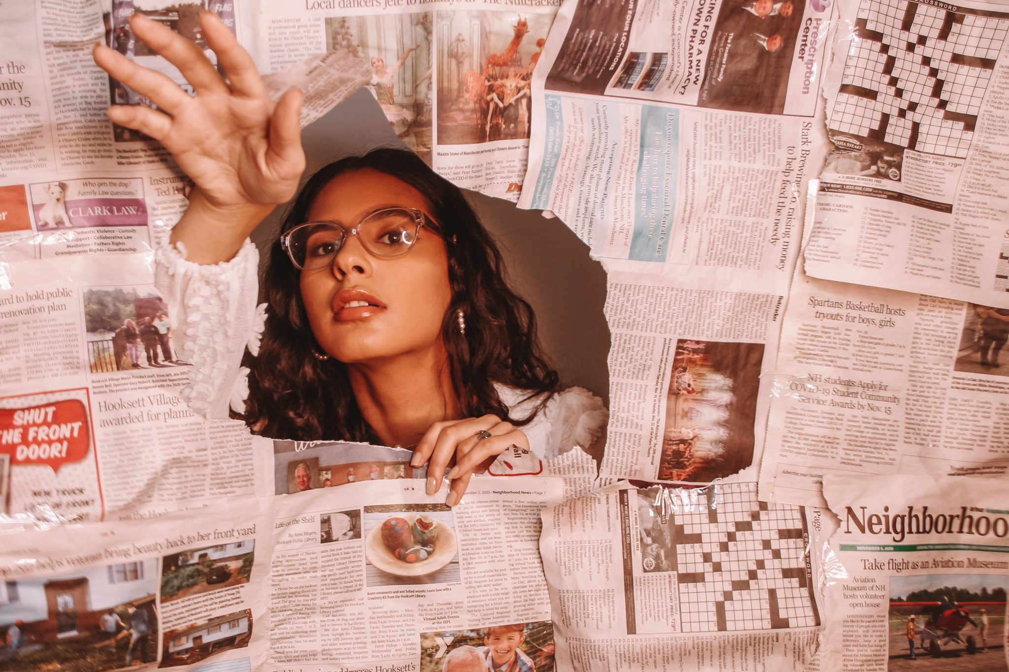 Alsina Nelselly (College of the Holy Cross, '21), Breaking News, photograph featuring news clippings, 12.3